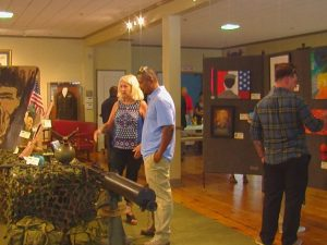Artwork from the 2016 Wounded Warrior Art Exhibition is displayed at the Hannah Block Historic USO & Community Arts Center (Photo: Sarah Johnson/WWAY)